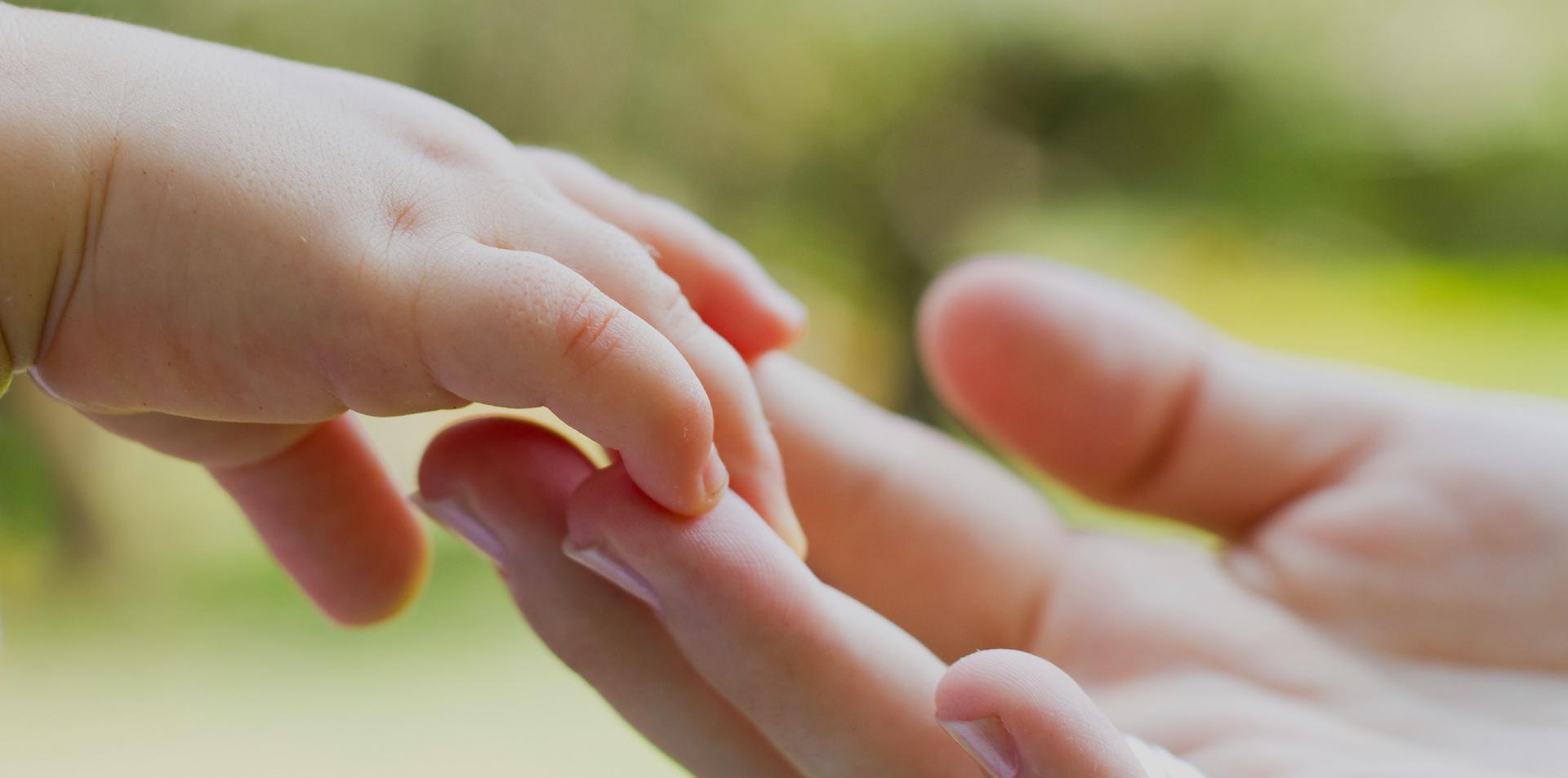 napier-fmaily-centre-holding-hands