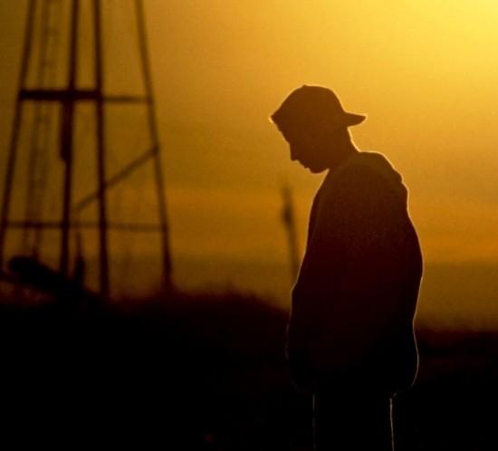 14563-boy-teen-sad-depressed-orange-man-sky-clouds-silhouette.1200w.tn